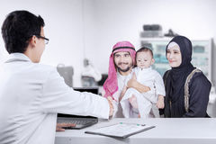 Arabian family visiting pediatrician Royalty Free Stock Images