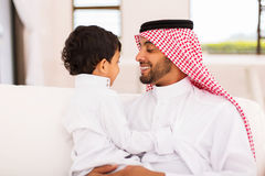 Arabian father son home Stock Photos