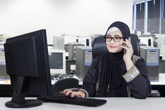 Arabian female worker works with computer stock photos