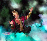 Arabian Genie. Floating on clouds and bringing treasures and fortune royalty free stock image