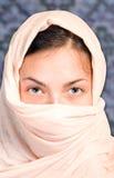 Arabian girl on blue background Royalty Free Stock Photography