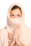 Arabian girl in peach color shawl. Isolated with clippiing path on white background stock photography