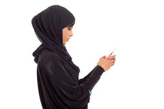Arabian girl smart phone. Side view of arabian girl using smart phone on white background Stock Image