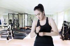 Arabian girl wearing smart watch at gym stock photo