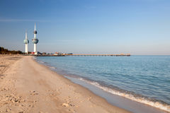 Arabian Gulf beach and the Kuwait Towers Royalty Free Stock Photography