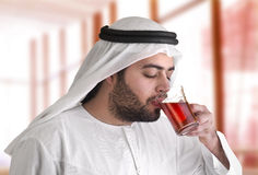 Arabian guy drinking tea / aroma tempting beverage Royalty Free Stock Photo