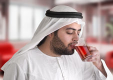 Arabian guy drinking tea / aroma tempting beverage Royalty Free Stock Photos