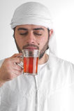 Arabian guy drinking tea / aroma tempting beverage Stock Image