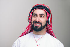 Arabian guy listening to music on headphones Stock Photography