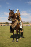 Arabian Horse with Costumed Rider. Beautiful Arabian horse with costumed female rider during a presentation at Horses and Horsepower Championship Polo at Royalty Free Stock Photo