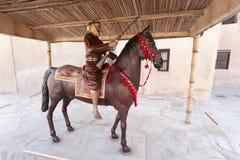 Arabian horseman warrior. AJMAN, UAE - DEC 17: Arabian horseman warrior at the museum of Ajman. December 17, 2014 in Ajman, United Arab Emirates Royalty Free Stock Image