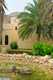 Arabian House. A luxurious arabian house in the desert with a pond in the front Royalty Free Stock Photo