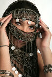 Arabian/indian woman. With her face covered Stock Image