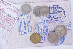 Arabian journey 2. Passport with United Arab Emirates and Kingdom of Bahrain entry stamps (204 and 2002) together with an air ticket and coins from the adjacent Royalty Free Stock Photo