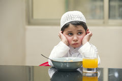 Arabian kid having breakfast of cornflakes and orange juice Stock Photography