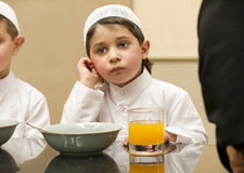 Arabian Kid having his breakfast Stock Photo