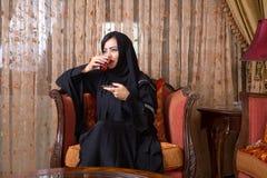 Arabian lady drinking tea at home Royalty Free Stock Photo