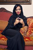 Arabian lady with hijab having fun while chatting Royalty Free Stock Photography