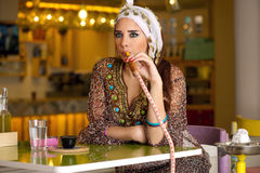 Arabian lady smoking hookah in the coffee shop Stock Photo