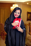 Arabian lady wearing hijab receiving a gift. Arabian lady wearing hijab happy for receiving a gift stock images