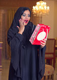 Arabian lady wearing hijab receiving a gift. Arabian lady wearing hijab happy for receiving a gift stock image
