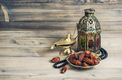 Arabian lantern, golden lamp fruits. Eid mubarak vintage Stock Photos