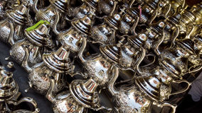 Arabian luxury. Group of Moroccan teapots in the window of a local flea market Royalty Free Stock Photography