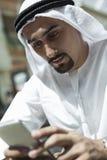 Arabian Male Using Smart Phone Stock Photography