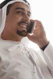 Arabian Male Using Smart Phone Indoors Stock Photography