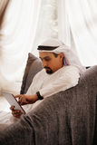 Arabian Male Using Smart Phone Indoors Royalty Free Stock Images