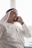 Arabian Male Using Smart Phone Indoors Royalty Free Stock Image