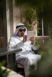 Arabian Male Using Smart Phone Out Stock Image