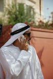 Arabian Male Using Smart Phone Outdoors Stock Photo