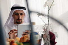 Arabian Male Using Tablet During Breakfast Stock Photography