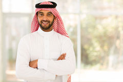 Arabian man arms crossed. Smiling arabian man with arms crossed Royalty Free Stock Images