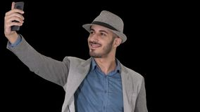 Arabian man in the casual clothes walking and making selfie, alpha channel. On alpha matte. Close up. Arabian man in the casual clothes walking and making selfie stock footage