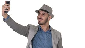 Arabian man in the casual clothes walking and making selfie on white background. Close up. Arabian man in the casual clothes walking and making selfie on white stock video footage