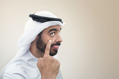 Arabian man doing a funny expression. Clumsy expression of an Arabian businessman Stock Photo