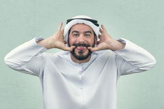 Arabian man doing a funny expression , Clumsy expression of an Arabian businessman.  Stock Images