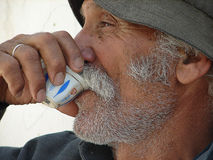 Arabian man drinking arabian coffee.  Stock Photos