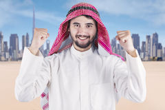 Arabian man expressing his success outdoors Stock Photos