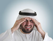 Arabian man having a headache. Clipping path included for isolation Royalty Free Stock Image