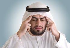 Arabian man having a headache. Clipping path included Stock Image