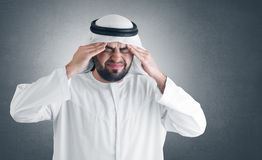 Arabian man having a headache + clipping path Stock Photography