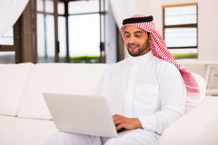 Arabian man laptop computer Stock Photo