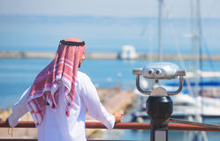 Arabian man looking at the yacht harbor Royalty Free Stock Photography