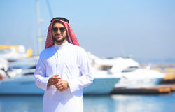 Arabian man looking at the yacht harbor Royalty Free Stock Photography