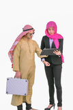 Arabian man and Muslim woman are discussing the project stock photo