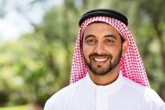 Arabian man outdoors. Close up portrait of happy arabian man outdoors Stock Images