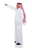 Arabian man pointing. Side view of arabian man pointing up, isolated on white Stock Photo